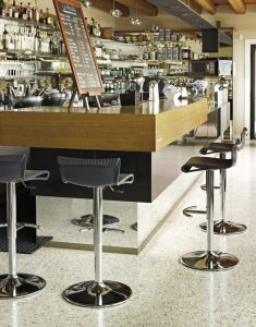 Conte Gas Lift Bar Stool NZ. Adjustable height around a Cafe Bar