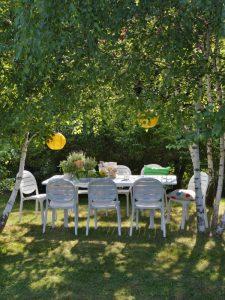 Erica Garden Chair NZ - White, outdoor setting.
