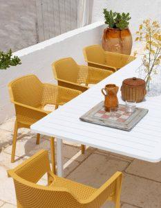Net Outdoor Cafe Chair NZ - Mustard, in Garden Setting