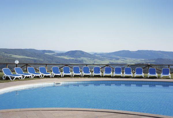 Omega Sun Loungers around Blue Pool
