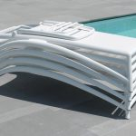 atlantico-sun-loungers-nz-stacked-by-pool