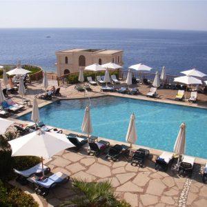 Eden Outdoor Sunloungers by Hotel Pool overlooking the Ocean
