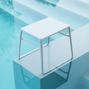 Pop Side Table Surrounded by Pool Water